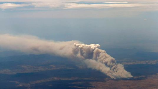 Smoke rises from the Yarrabin bushfire