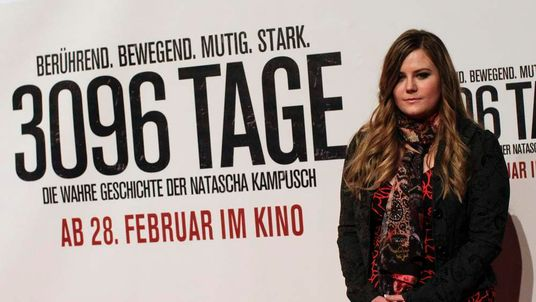 """Austrian kidnap victim Natascha Kampusch poses in front of a film poster before the premiere of the film """"3,096 Days"""" in a cinema in Vienna"""