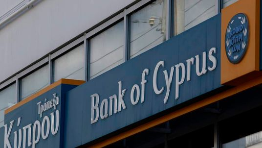 Tho logo of the Bank of Cyprus is seen at one of its branches in Athens