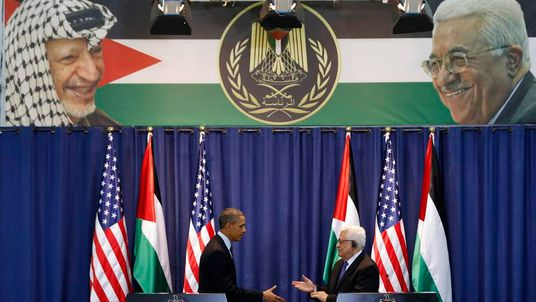 U.S. President Obama and Palestinian President Abbas shake hands at a news conference in Ramallah