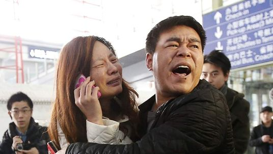 Anxious relatives wait for news about loved ones in Beijing, China