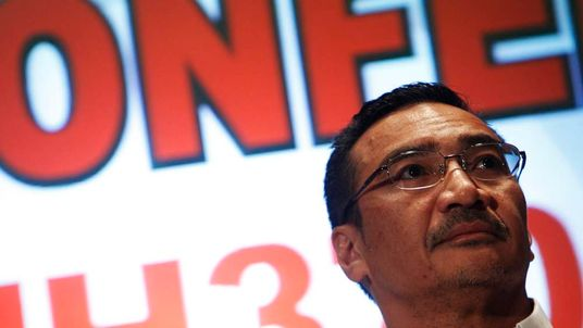 Malaysia's Transport Minister Hishammuddin Hussein listens during a news conference about the missing Malaysia Airlines flight MH370, at Kuala Lumpur International Airport.