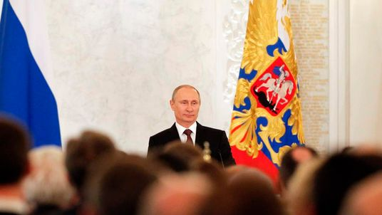 Russian President Vladimir Putin addresses the Federal Assembly at the Kremlin in Moscow