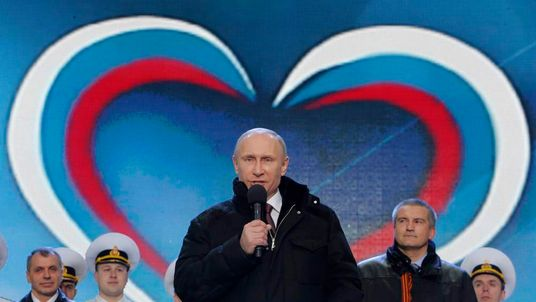 "Russia's President Putin addresses audience during a rally and concert called ""We are together"" to support annexation of Ukraine's Crimea to Russia, at Red Square in central Moscow"