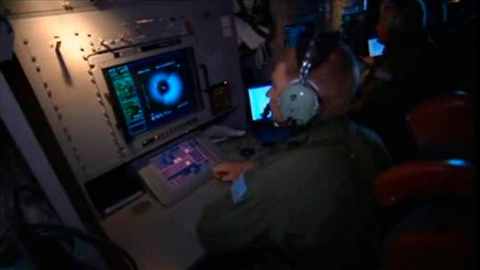 Crew monitor search equipment on board RAAF P3 Orion aircraft are pictured during a sea search for the missing Malaysia Airlines flight MH370 in an area between Australia, southern Africa and Antarctica