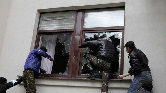 Pro-Russian activists storm the regional government headquarters in Luhansk