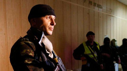 Pro-Russian armed men stand in the seized regional prosecutor's office in Luhansk