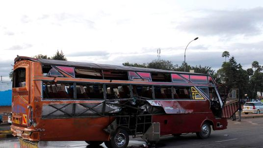 A bus damaged after an explosion is seen along the Thika super-highway in Kenya's capital Nairobi