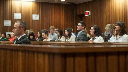 Olympic and Paralympic track star Oscar Pistorius sits in the dock in the North Gauteng High Court in Pretoria