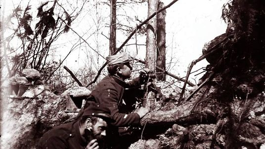 An undated archive picture shows French artillery officers on the phone relaying instructions to adjust cannon fire in a trench on the front line, at an unknown location in France