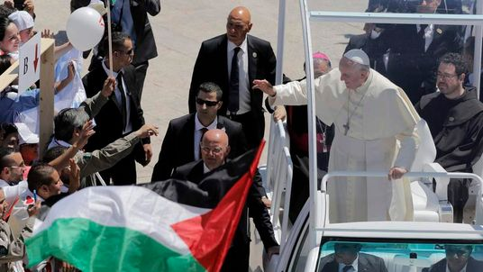 Pope Francis waves to the crowd during his visit to the West Bank town of Bethlehem