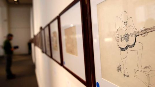 An untitled drawing of a four-eyed guitar player by John Lennon is seen during the press preview of a collection of Lennon's original drawings and manuscripts from 1964-65 at Sotheby's auction house in New York