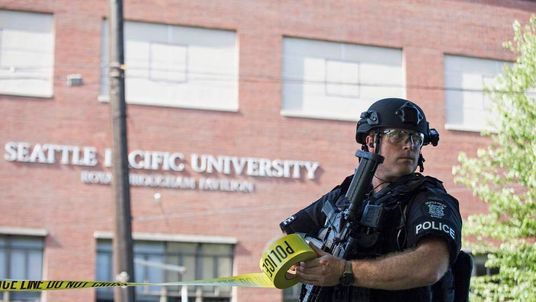 A policeman secures the scene at Seattle Pacific University after the campus was evacuated due to a shooting in Seattle, Washington.