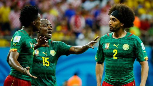 Cameroon's Weboc tries to separate Moukandjo and Assou-Ekotto as they argue during their 2014 World Cup Group A soccer match against Croatia at the Amazonia arena in Manaus