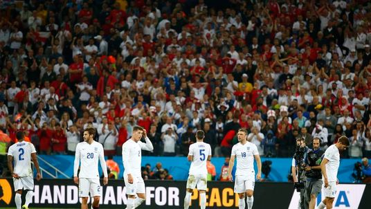 England players react to a goal by Uruguay's Luis Suarez during the 2014 World Cup Group D soccer match between Uruguay and England at the Corinthians arena