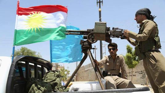 A military convoy drives towards Kirkuk, to reinforce Kurdish Peshmerga troops in Kirkuk