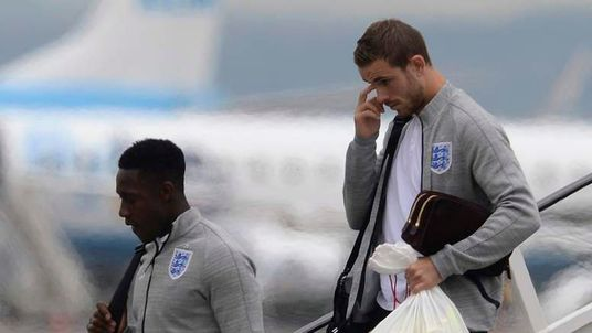 England's Henderson and Welbeck arrive back from the 2014 World Cup in Brazil at Manchester airport