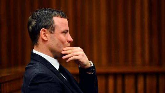Oscar Pistorius sits in the dock during his murder trial in Pretoria, South Africa