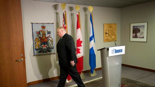 Toronto Mayor Rob Ford leaves the podium following an invite-only news conference at City Hall in Toronto