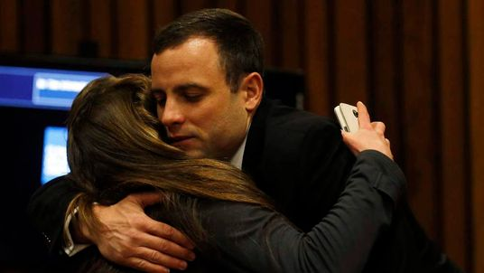 South African Olympic and Paralympic sprinter Oscar Pistorius greets a well wisher during his murder trial in the North Gauteng High Court in Pretoria.