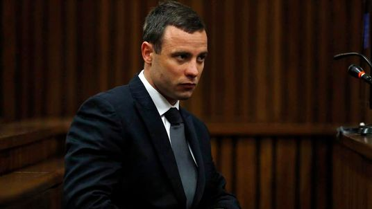 Oscar Pistorius sits in the dock