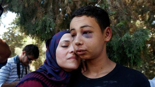 Tariq Abu Khadair and his mother Suha Abu Khadair outside court