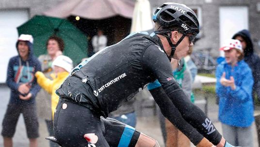 Team Sky rider Froome of Britain rides in torn cycling costume after falling in the 5th stage of the Tour de France