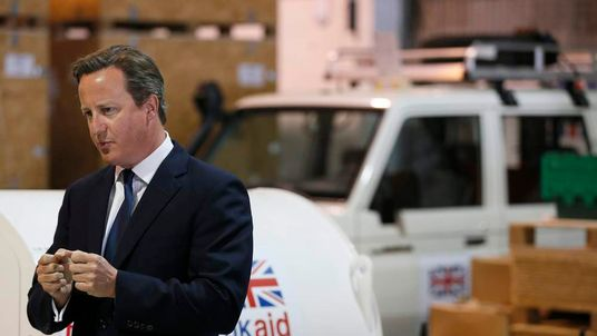 Britain's Prime Minister David Cameron speaks during a visit to a UK aid Disaster Response Centre at Kemble Airport, southern England