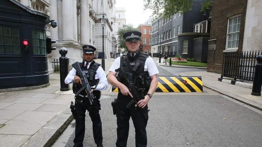Armed police officers in Downing Street, central London