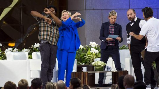 "Hillary Clinton dances with DJ ""Twitch"" next to Ellen DeGeneres during a taping of ""The Ellen DeGeneres Show"" in New York"