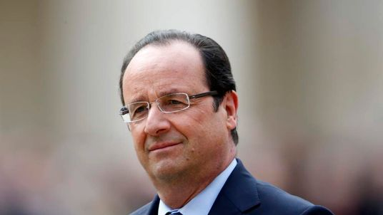 France's President  Hollande attends a military ceremony in the courtyard of the Invalides in Paris