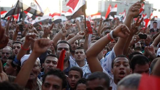 Anti-Mursi protesters chant in Tahrir Square in Cairo