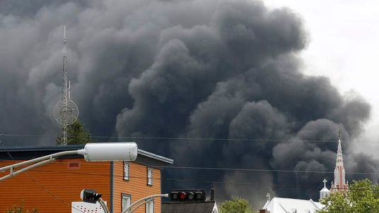 A cloud of smoke is seen over Lac Megantic after a train explosion