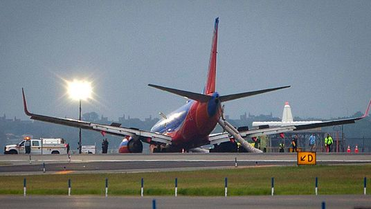 Southwest Airlines Boeing 737 sits on the tarmac at LaGuardia airport, after making an emergency landing without its nose gear, in New York