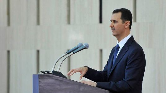 Syria's President Assad delivers a speech while attending an Iftar during the Muslim month of Ramadan in Damascus