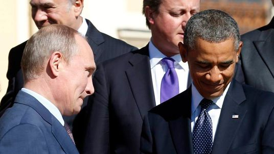 Putin walks past Obama at the G20 in St Petersburg