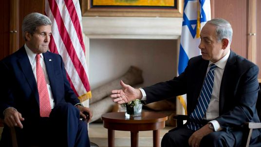 Israel's PM Netanyahu reaches out to shake hands with U.S. Secretary of State Kerry in Jerusalem