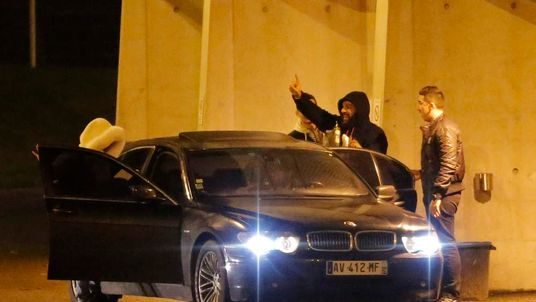 French humorist Dieudonne M'bala M'bala, also known as Dieudonne, waves as he leaves the Zenith concert hall where he was to hold his show in Nantes,