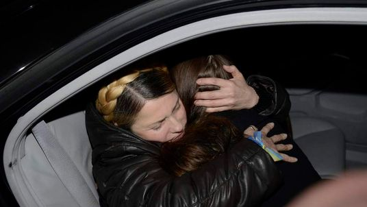 Ukrainian opposition leader Yulia Tymoshenko hugs daughter Yevgenia.