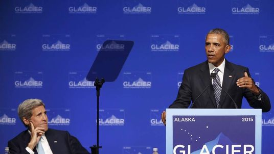 US President Obama is flanked by US Secretary of State Kerry as he delivers remarks to the GLACIER Conference at the Dena'ina Civic and Convention Center in Anchorage, Alaska.