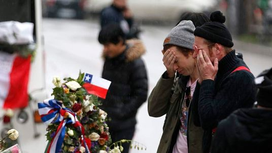 Jesse Hughes and Julian Dorio, members of Eagles of Death Metal band, mourn in front of the Bataclan concert hall to pay tribute to the shooting victims in Paris