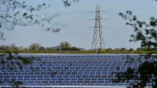 Solar panels are seen in fields near Andover in southern England
