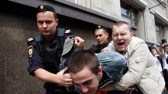 Russian police detain a gay rights activist during a rally outside the Duma in Moscow