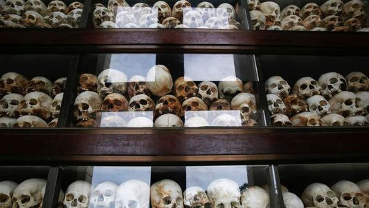 "Skulls are placed behind glass at a memorial stupa made with the bones of more than 8,000 victims of the Khmer Rouge regime at Choeung Ek, a ""Killing Fields"" site located on the outskirts of Phnom Penh"