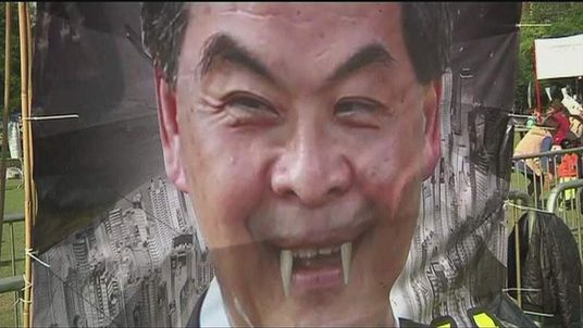 Poster depicting Hong Kong leader  Leung Chun-ying as a vampire