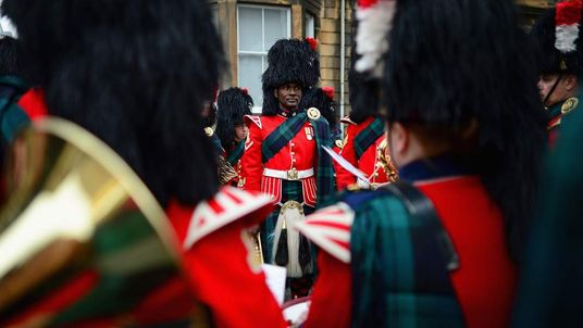 Members of the band of the Royal Regiment of Scotland prepare to take part in The Royal Scots Dragoon Guards Homecoming Parade