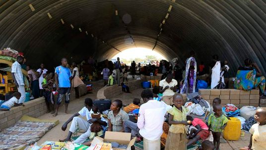 Families displaced by recent fighting in South Sudan, camp in a warehouse in Jabel