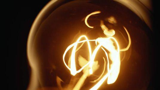 A glowing light bulb filament