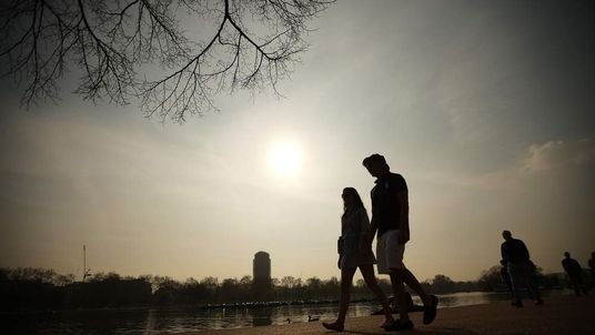 Couple Enjoy The Spring Sunshine In London