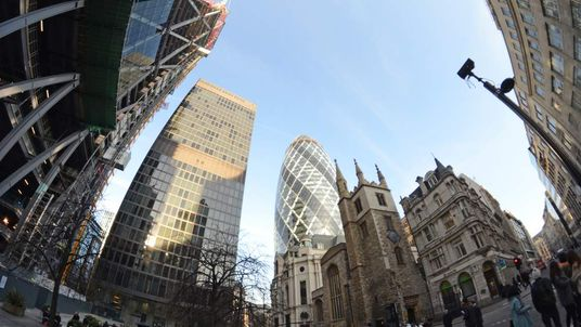 The Gherkin is seen from in front of the Lloyds TSB building, central London
